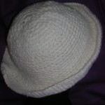 White Bunmi Bucket Hat - brim rolled up - back